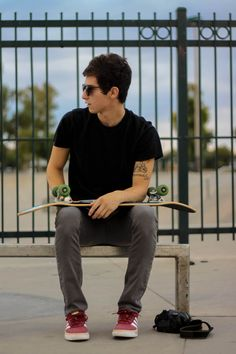 he doesnt need to be holding a skateboard...it just so happens that skaters always seem to wear good clothes