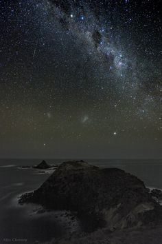 A meteor streaks across the sky off the coast of Phillip Island Australia. Canopus, the second brightest star in the night sky is notable on the lower right and Achernar is closer to the horizon on the lower left. Higher up in the sky is the prominent constellation of the Southern Cross--next to the Coalsack dark nebula. Stars Alpha and Beta Centauri shine brightly along the upper edge of the photo.