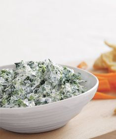 SPINACH & PARMESAN DIP:  1 	 10-oz pkg frozen chopped spinach, thawed; 1 cup sour cream; 1/4 cup grated Parmesan (1 oz); 1 clove garlic, finely chopped; kosher salt & black pepper