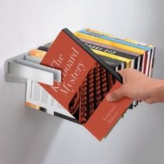 works just like my magazine rack, but it might be a little rough on the books.