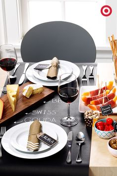 Personalize your party with black Spritz party paper used as placemats and a cheese plate. The chalkboard vibe will elevate your small plates and snacks into something extra special.