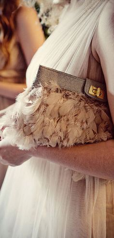 What woman doesn't love to wear different handbags on different occasions? see this..  http://voilachic.com/
