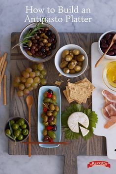Entertaining for the holidays? Impress your friends with a gorgeous and delicious Antipasto Platter complete with a variety of olives, meats and cheeses. Learn how to make your own!