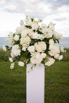 i want all white flowers at the church :)