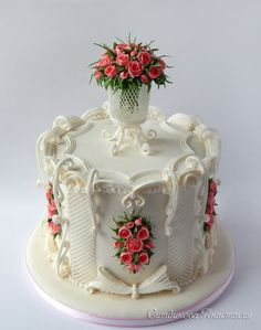 CAKE ART ! ~ Royal Icing  All sugar roses, lattice vase, over piped wings and   curved lattice panels.  ~ Beautifully   designed and executed!