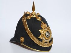 An 1878 pattern Home Service Helmet (Blue Cloth) to the South Wales Borderers.
