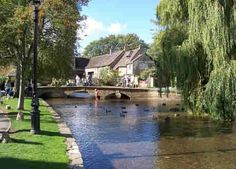 Bourton-on-the-Water in the Cotswolds.  The most chocolate box village in England, with its little bridges crossing the River Windrush, and little honey coloured stone cottages.