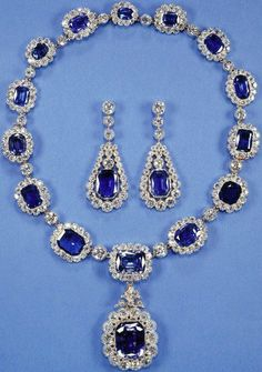 """King George VI's Victorian Suite"""". Made around 1850, purchased by King George VI of Great Britain, who presented it to his daughter princess Elizabeth of Great Britain when she married prince Philip of Greece in 1947. It is a necklace of sixteen sapphires surrounded by diamonds, and a pair of earrings. In 1952, Queen Elizabeth II had it shorten by removing the largest and three of the smallest stones. Since 1959 the largest one is used as a pendant , but it can also be used as a brooch."""