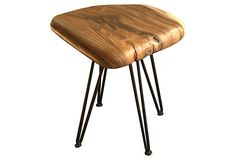 Pebble Stool - a favorite of interior designers for good reason, the pebble stool has a rounded acacia seat with metal legs. No two stools are exactly alike, and they may vary slightly from the image.