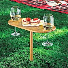 Stake your claim to enjoying wine or champagne---anywhere outdoors! Just find a penetrable surface (grass, sand, dirt) to insert the post of this portable wine table.