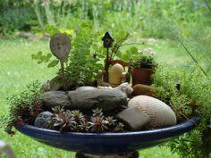 a bird bath fairy garden.