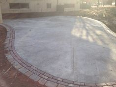 Concrete patio with brick and paver edging. #TopekaLandscape