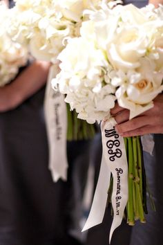 bridesmaids monogram on their bouquets