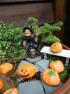 s make your neighbors giggle with these 9 halloween fairy garden ideas, gardening, halloween decorations, seasonal holiday decor, Paint pebbles and rocks as pumpkins