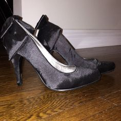 BLACK SATIN BOW HEELS BLACK SATIN BOW HEELS. WORN ONCE. EXCELLENT CONDITION. NO BOX. NO TRADES. Wet Seal Shoes Heels