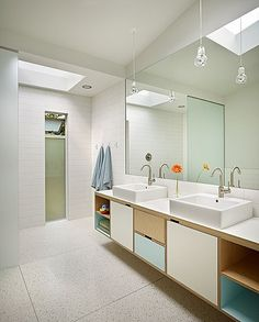 Beautiful mid-century modern home in Lakewood, WA | Floating vanity built by Kerf Design - http://kerfdesign.com