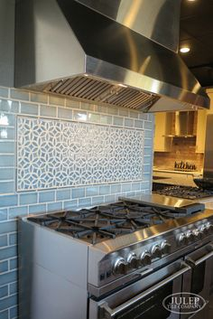 Adding a decorative accent over the range is a great way to bring pattern into your kitchen. Shown here is our Bloom pattern and Subway Tile, both in Deep Blue Crackle | juleptile.com