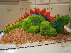 How to Make a Dinosaur Birthday Cake. You'll be a legend in your child's mind if you surprise them with a fully-formed, beautiful-looking dinosaur cake. If your kids love dinosaurs, making a dinosaur birthday cake is a great way to. Easy Kids Birthday Cakes, Dinosaur Birthday Cakes, Dinosaur Party, Boy Birthday, Birthday Parties, Birthday Ideas, Dinosaur Cake Easy, Dinosaur Cake Tutorial, Dinosaur Cupcake Cake