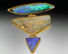 Shaw Gallery - Maine. Curious combinations of distinct Australian boulder opals are endlessly fascinating.  Set in 22K gold with 14K hinges.