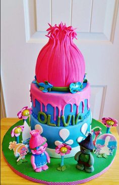My beautiful granddaughter Olivia turned 4 and she wanted everything troll including her cake. Poppy's hair is RKT covered in fondant. The second and bottom tier represent her dress! Poppy troll and her troll friends are edible images Branch troll. Trolls Birthday Party, Troll Party, Birthday Parties, Birthday Celebrations, Birthday Cake Card, Birthday Cake Girls, 4th Birthday, Birthday Ideas, Cakepops