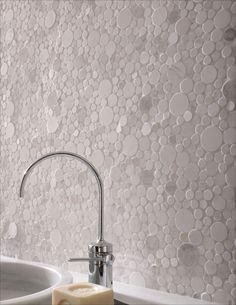 Want a subtly unique splash? Try a conventional color in an unusual shape. White Moon Mosaic pebble tile