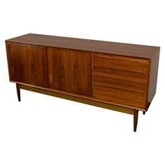 Mid Century Danish Teak Credenza | From a unique collection of antique and modern credenzas at http://www.1stdibs.com/furniture/storage-case-pieces/credenzas/