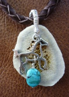 Hunter necklace, hand braided deer skin, antler slice, sterling silver wire and horse charm accented with turquoise, $55