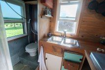 Don't even mind that there isn't a sink in the bathroom....I now only have one sink in my Bus and it works out, just fine :)