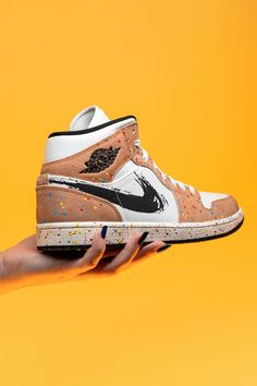"""Always up for interpretation, the Air Jordan 1 Mid plays host to one of the year's most creative colorways on the """"Brushstroke."""" Colorful paint splatters on the overlays and midsole and a black brushstroke Swoosh are an artist's rendition of the shoe."""