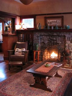 Rainy day fire...windows above built-in bookcases on either side of fireplace were popular craftsman idea.
