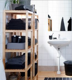 Open shelving puts things within easy reach. To avoid a messy look, limit storage bins and/or linens to 2 or 3 colors, as IKEA has done here!