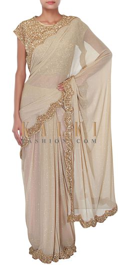 Buy Online from the link below. We ship worldwide (Free Shipping over US$100) http://www.kalkifashion.com/gold-saree-with-enhanced-border-only-on-kalki.html