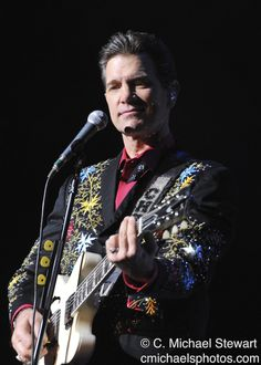 Chris Isaak - not exactly Rock N' Roll, but with his exceptional back up band, he sure can Rock at times (check out 'American Boy')