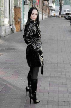 Black pvc short trench coat black hose and high heel boots