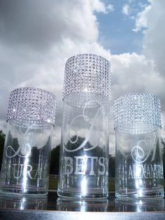 Personalized Bridal/Bridesmaids Bouquet Holders.........set of 6 on Etsy, $150.00. I thought these would be great for the head table. :)