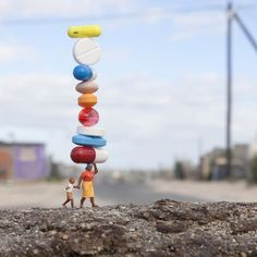 BALANCING ACT Khayelitsha Township Cape Town South Africa 2011  This was shot in Khayelitsha township a deprived 'shanty town' outside of Cape Town. Sales from this work went to support Baphumelele Children's Home which does amazing work helping children affected and orphaned by HIV/AIDS. To find out more go to Baphumelele.org.za The image has also been used by @unicef for HIV / AIDS awareness outreach and is part of their collection. by slinkachu_official