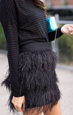 "The new IT item you probably don't have in your closet"" feather skirts."
