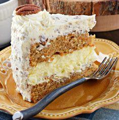 Carrot Cake Cheesecake Cake...the ultimate dessert idea! #creamcheesefrosting #pecans #carrotcake #cheesecake