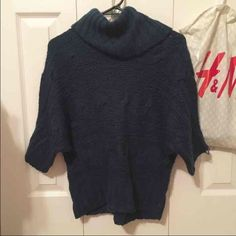 Rue 21 sweater Rue 21 navy turtle neck quarter sleeve sweater. Size medium but fits like a small Rue 21 Sweaters Cowl & Turtlenecks