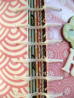 Link Stitch book binding (how-to at the bottom of page) http://americancrafts.typepad.com/studio/2010/01/book-reviews-book-by-paige.html #bookbinding #tutorial