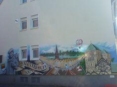 Kreative Fassadenmalerei mit Stadtbild von Martin Arens Malermeister in Münster (48155) | Maler.org