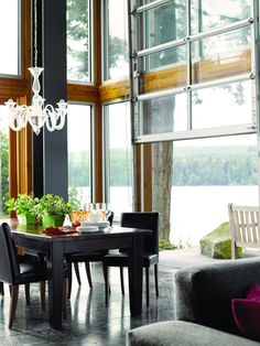 Chic dining room - Love the chandelier, love the unique door opening to such a view!!