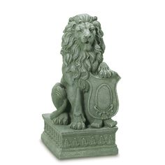 Lion Guardian Statue    With his mighty paw placed atop a crested shield, a regal lion surveys all who approach the door to your castle, or entryway to your garden.  @ amazingwebshopperonline.com