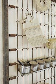 idea of the day: turn an old bed frame into a wall-storage grid