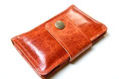 Leather iPhone Wallet in Pumpkin Orange. $52.00, via Etsy.