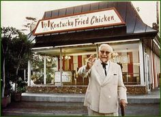 Vintage photo of Colonel Sanders himself in front of KENTUCKY FRIED CHICKEN not KFC.