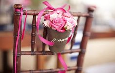 Groom and Bride's chair embellishments with pink roses and satin ribbons