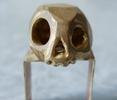 Skull Ring by marmod8 @ Uncovet // rough finish and cartoon features are great