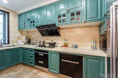 Beautiful high end blue-green American Home kitchen 2015