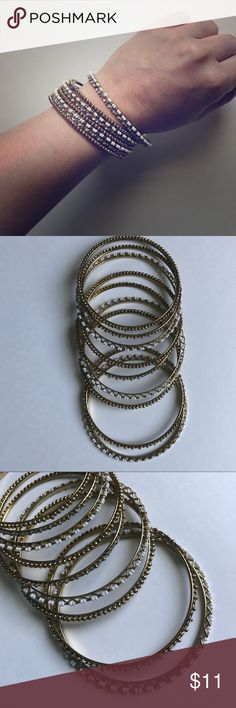 Gold and White Bangle set of 9 9 bracelets with 3 per design. Cute as a set or individual pieces. Perfect condition, hardly used. Sold as a set. natasha Jewelry Bracelets